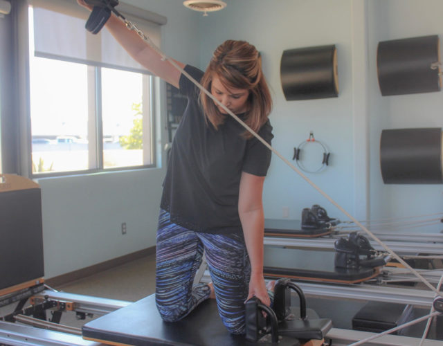 woman active on a reformer